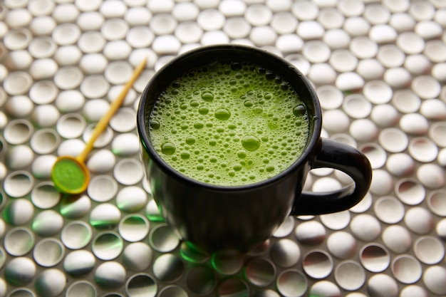 Matcha green tea from japan on stainless steel