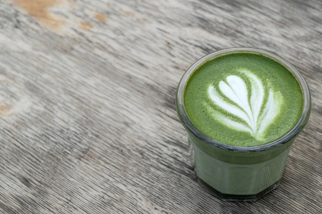 Matcha, green tea in glass cup. grey stone background. close up. top view. place for text.