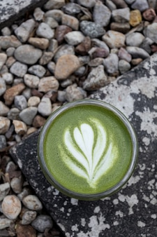 Matcha, green tea in glass cup. grey stone background. close up. top view. refreshing summer drinks recipes.