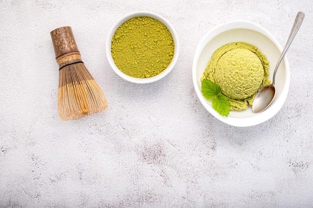 Matcha green tea ice cream with a matcha whisk