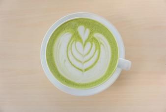Matcha green tea latte with heart shape latte art