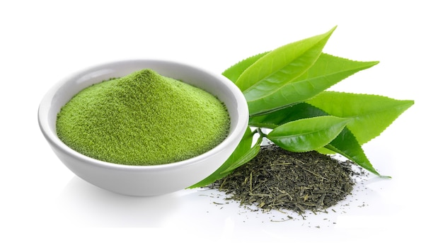 Matcha green tea powder in a bowl on white background