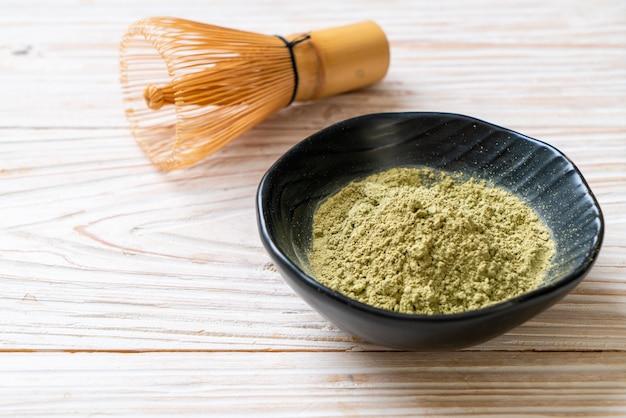 Matcha green tea powder with whisk