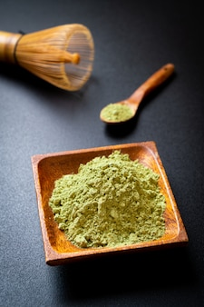 Matcha green tea powder with whisk