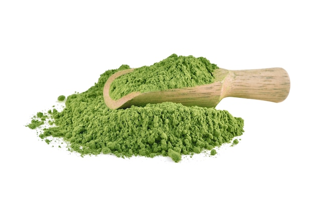 Matcha green tea powder with wooden spoon isolated on white background.