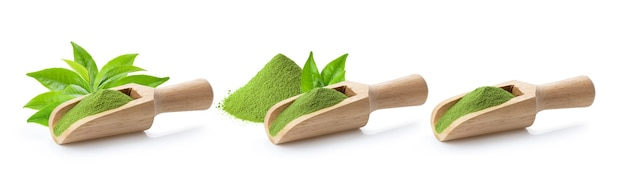 Matcha green tea powder in wood scoop and leaf on white surface