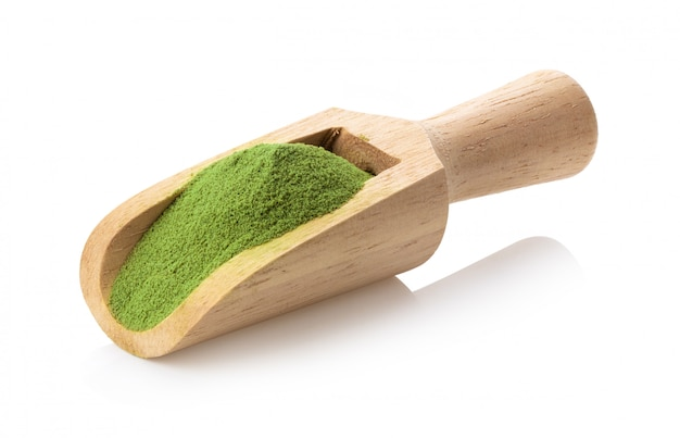 Matcha green tea powder in wood scoop