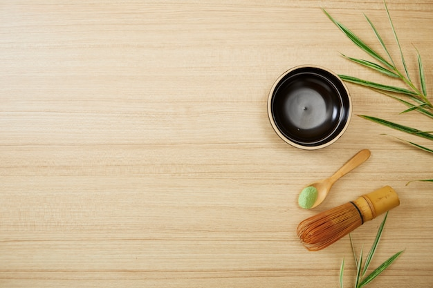 Matcha green tea on wood background