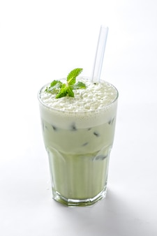 Matcha ice blended with whipped cream and mint leaves on top