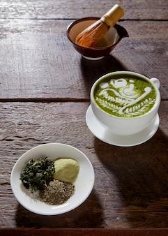 Matcha latte wood background