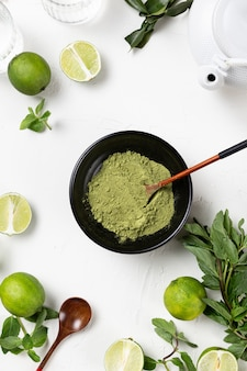 Matcha and limes on a white background