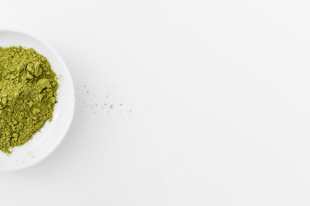Matcha powder in a bowl with copy space