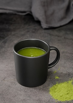 Matcha tea in cup with powder