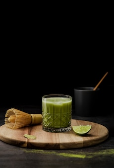 Matcha tea in glass with lime and copy space