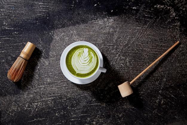 Matcha tea latte on black table