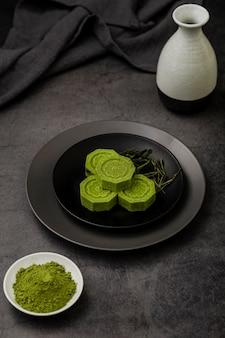Matcha tea on plate with herbs