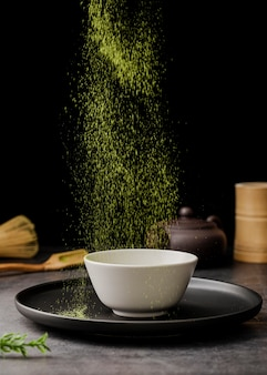 Matcha tea powder sieved in bowl