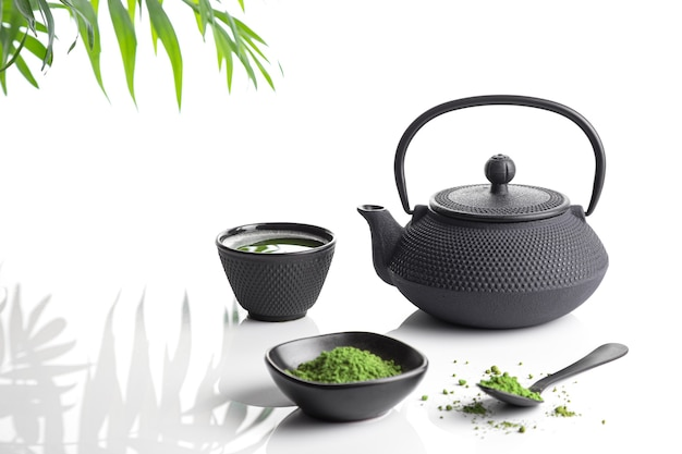Matcha tea powder and tea accessories on white base. tea ceremony. traditional japanese drink