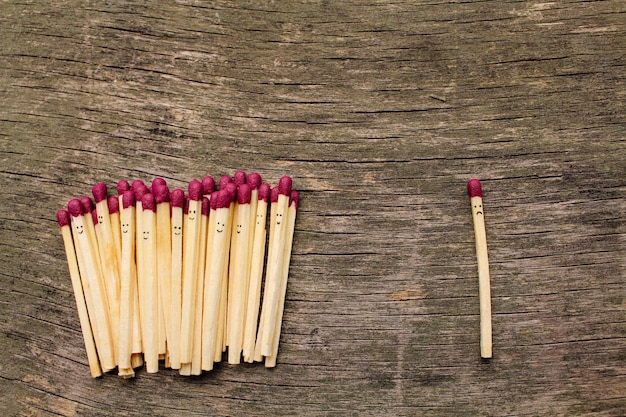 Matches on wooden background
