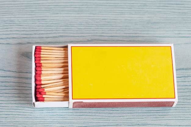 Matchstick on color wood table.