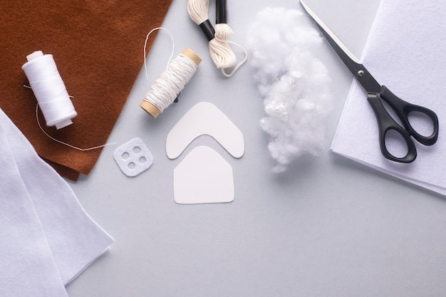 Materials for sewing a christmas gingerbread house from felt. flat lay