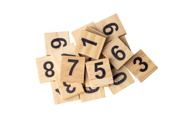 Математический номер деревянный на белом фоне.