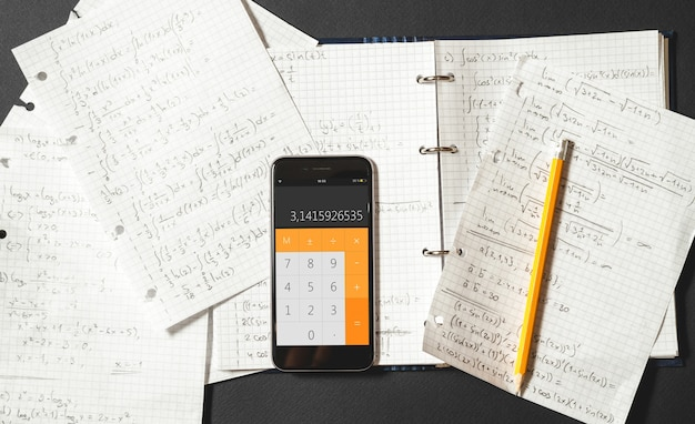 Mathematical equations are written in a notebook