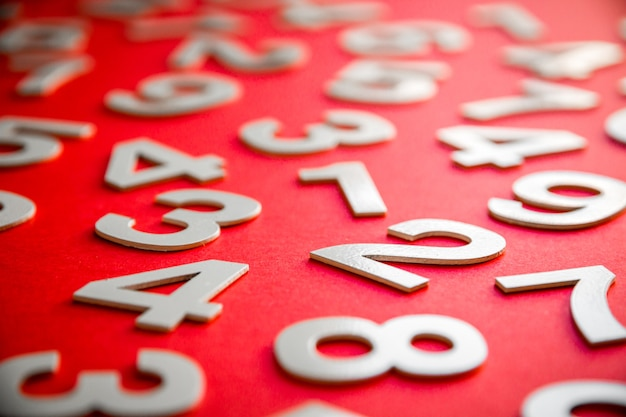 Mathematics background made with solid numbers on a board. isolated on red