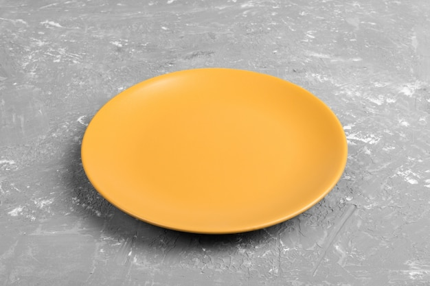 Matte round empty yellow dish