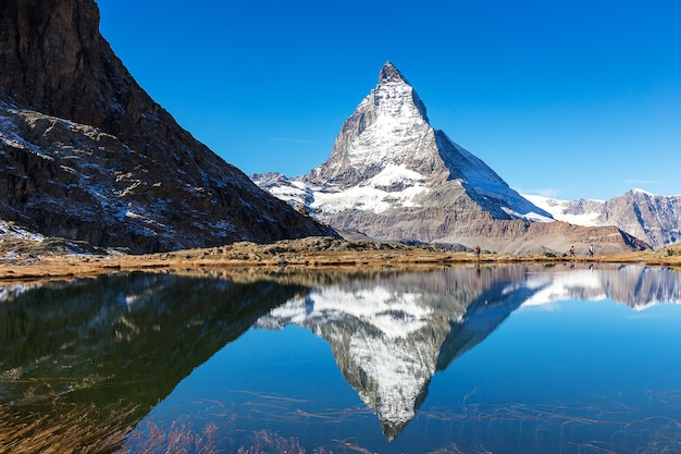 Matterhorn mountain view from riffelsee lake on high mountain in