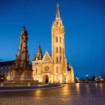 Matthias church and statue of holy trinity in budapest, hungary