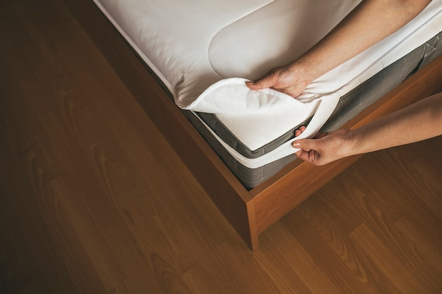 Mattress pad on the mattress