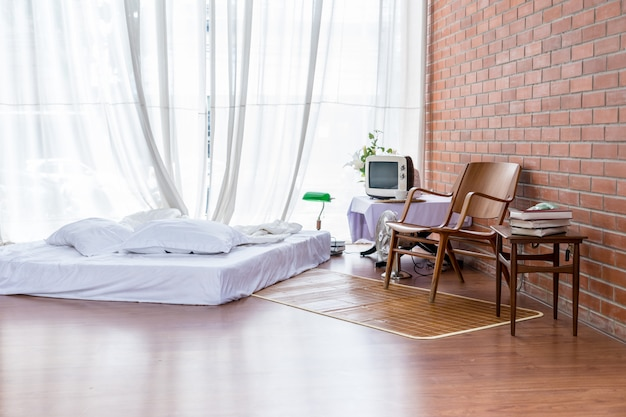 Mattress in the room with a table and chair