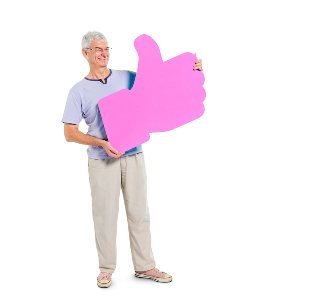 Mature adult holding thumbs up symbol