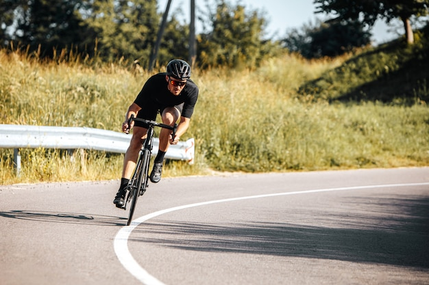Mature athlete riding bicycle on fresh air