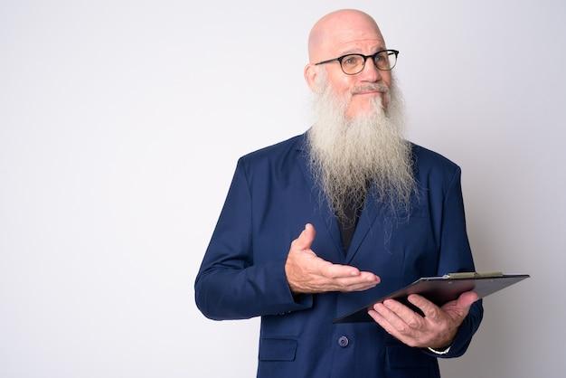 スーツと眼鏡を身に着けている長いひげを持つ成熟したハゲの実業家