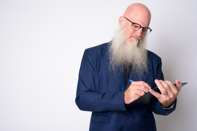 Mature bald businessman with long beard wearing suit and eyeglasses