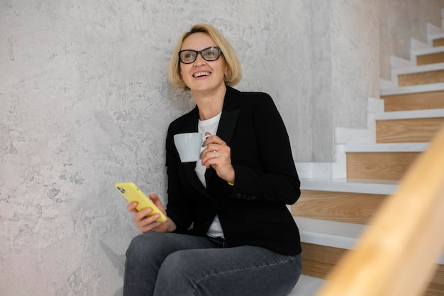 Mature blonde business woman at work