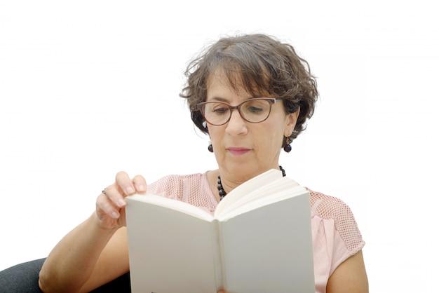 Mature brunette woman reading a book