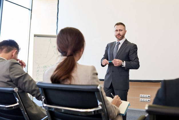 Mature businessman giving presentation