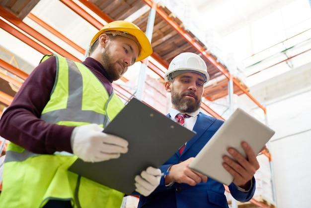 Mature businessman inspecting warehouse