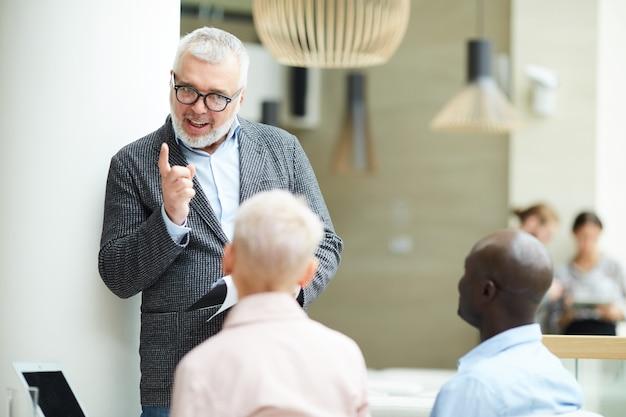 Mature businessman leading training seminar