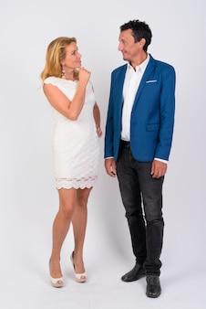 Mature businessman and mature businesswoman together