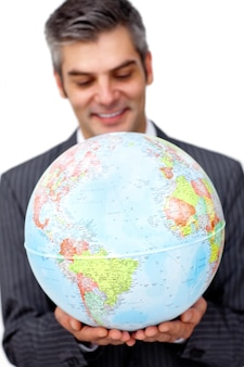Mature businessman smiling at global business expansion