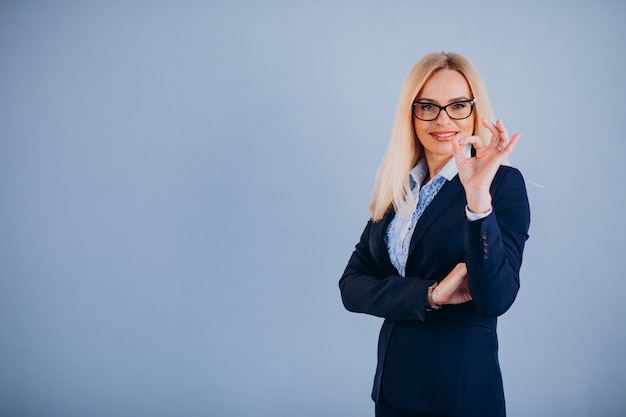 Mature businesswoman isolated in classy outfit