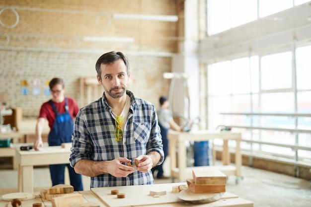 Mature carpenter posing