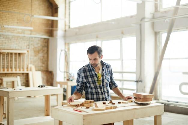 Mature carpenter in workshop