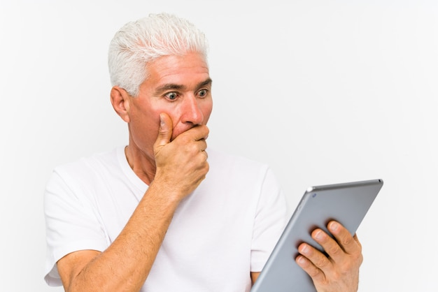 Mature caucasian man holding a tablet