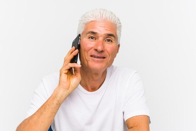 Mature caucasian man talking on phone