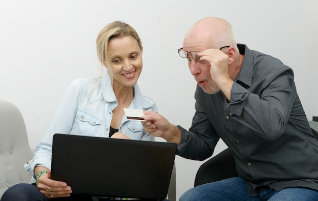 Mature couple e-shopping on internet